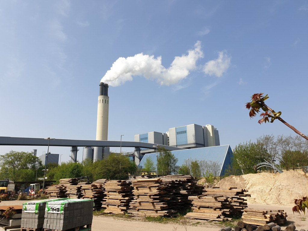 A chimney billows out steam at Berlin's Reuter Wes...
