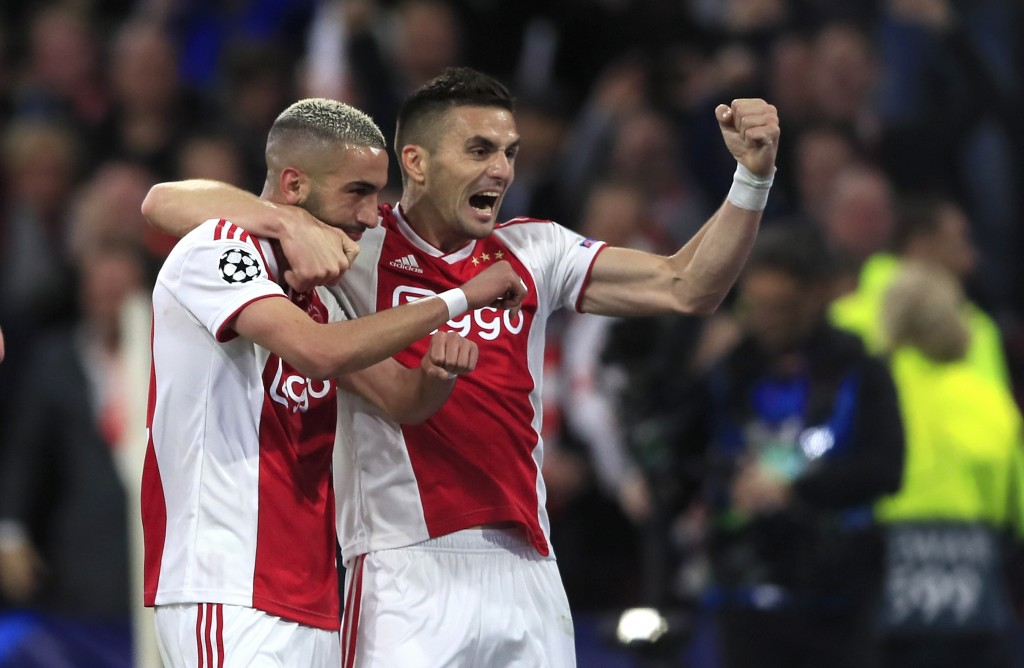 Ajax's Hakim Ziyech celebrates with Dusan Tadic, right,after scoring his side's second goal during the Champions League semifinal second leg soccer ma