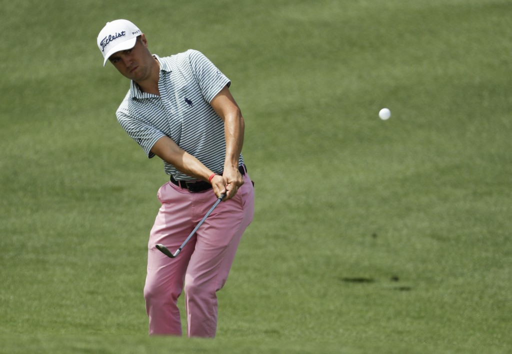 FILE - In this Thursday, April 11, 2019, file photo, Justin Thomas hits to the second green during the first round for the Masters golf tournament in ...