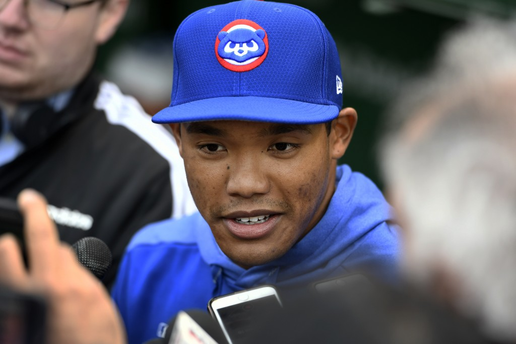 Chicago Cubs shortstop Addison Russell speaks to the media in the dugout before a baseball game against the Miami Marlins, Wednesday, May 8, 2019, in ...