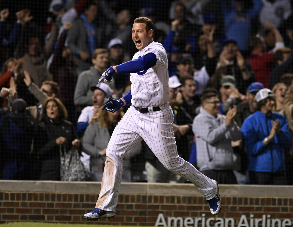 Chicago Cubs' Anthony Rizzo celebrates after Jason Heyward hit a game-winning solo home run in the 11th inning of a baseball game against the Miami Ma...