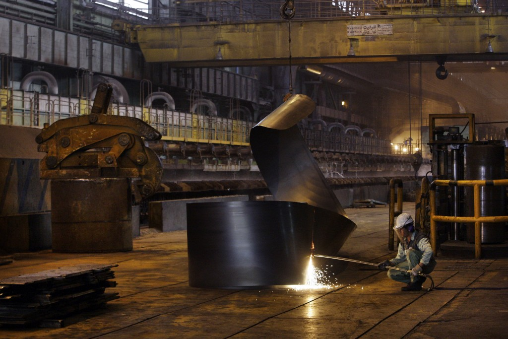 FILE - In this May 31, 2012 file photo, an Iranian worker cuts a steel roll at the Mobarakeh Steel Complex, some 280 miles (460 kilometers) south of t...