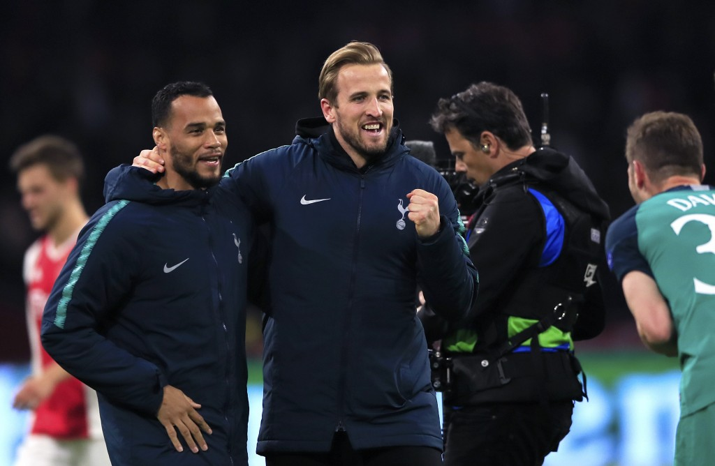 Tottenham's Harry Kane, center, celebrates at the end of the Champions League semifinal second leg soccer match between Ajax and Tottenham Hotspur at