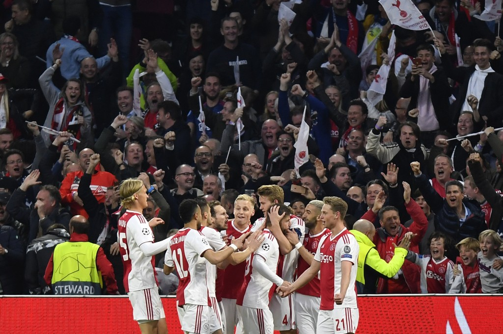 Ajax's Matthijs de Ligt celebrates with teammates after scoring his side's opening goal during the Champions League semifinal second leg soccer match