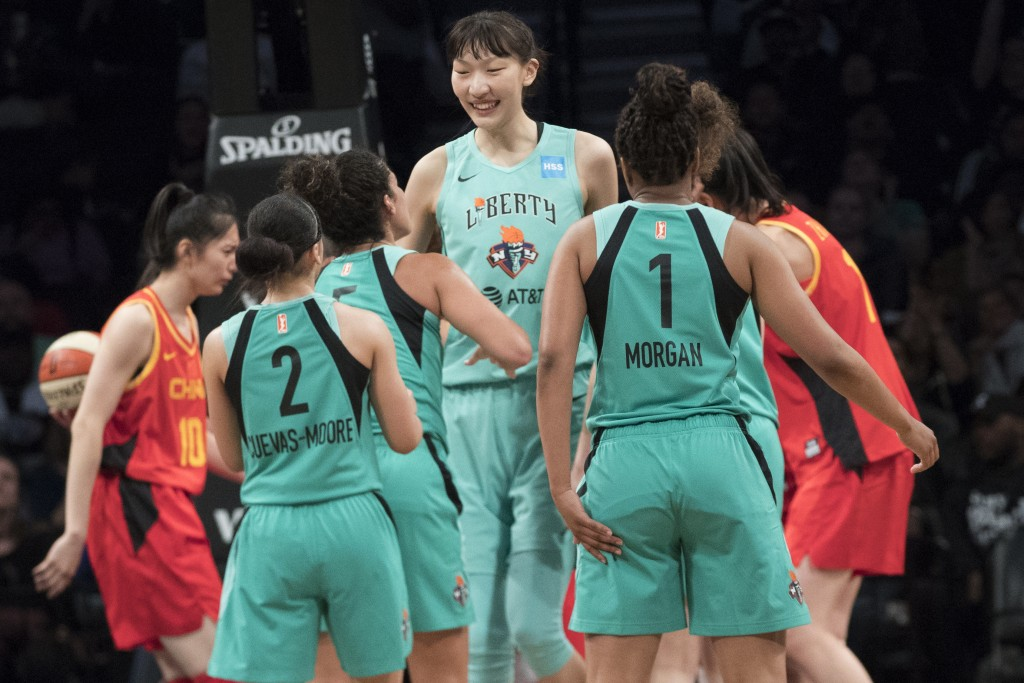 New York Liberty center Han Xu, center, celebrates her goal with her teammates during the second half of the team's WNBA exhibition basketball game ag...