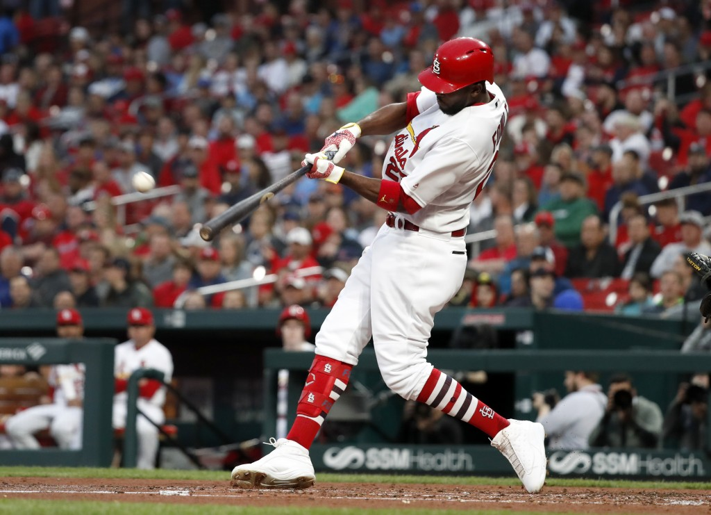 St. Louis Cardinals' Dexter Fowler hits a ground-rule double to score two runs during the second inning of the team's baseball game against the Pittsb...