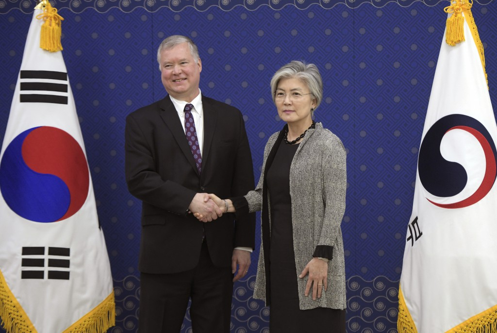 U.S. Special Representative for North Korea Stephen Biegun, left, shakes hands with South Korea's Foreign Minister Kang Kyung-wha during their meeting...