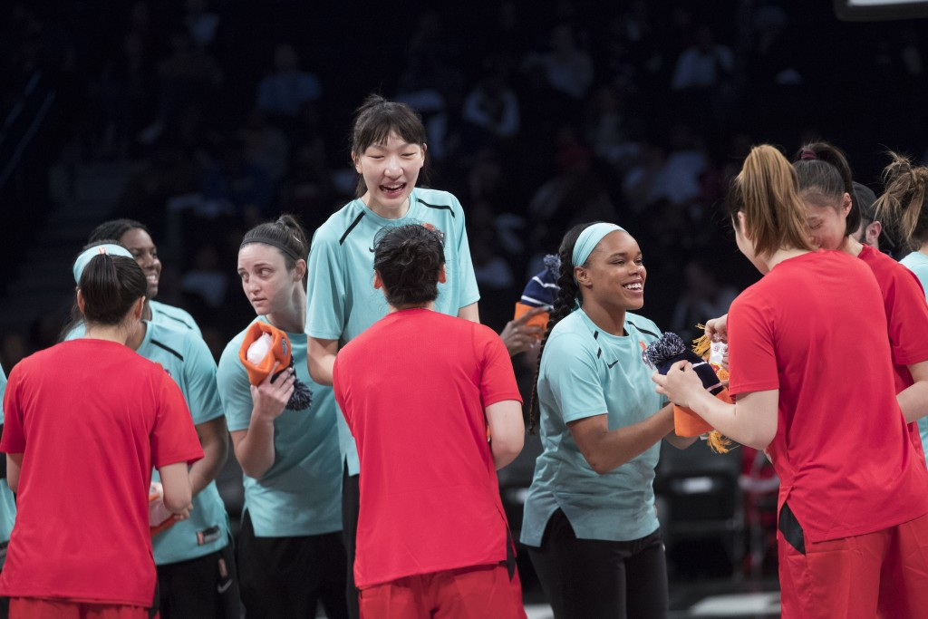 New York Liberty center Han Xu, center, exchanges gifts with the Chinese team players before a WNBA exhibition basketball game Thursday, May 9, 2019,