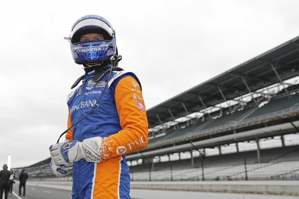 Scott Dixon, of New Zealand, waits during a practice session for the Indy GP IndyCar auto race at Indianapolis Motor Speedway, Friday, May 10, 2019 in