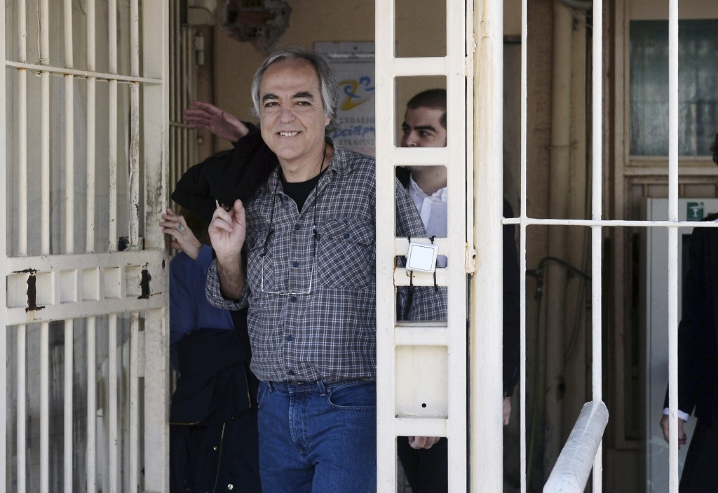 FILE - In this Thursday, Nov. 9, 2017 file photo, Dimitris Koufodinas smiles as he leaves Korydallos prison in western Athens.  A Greek far-left extre