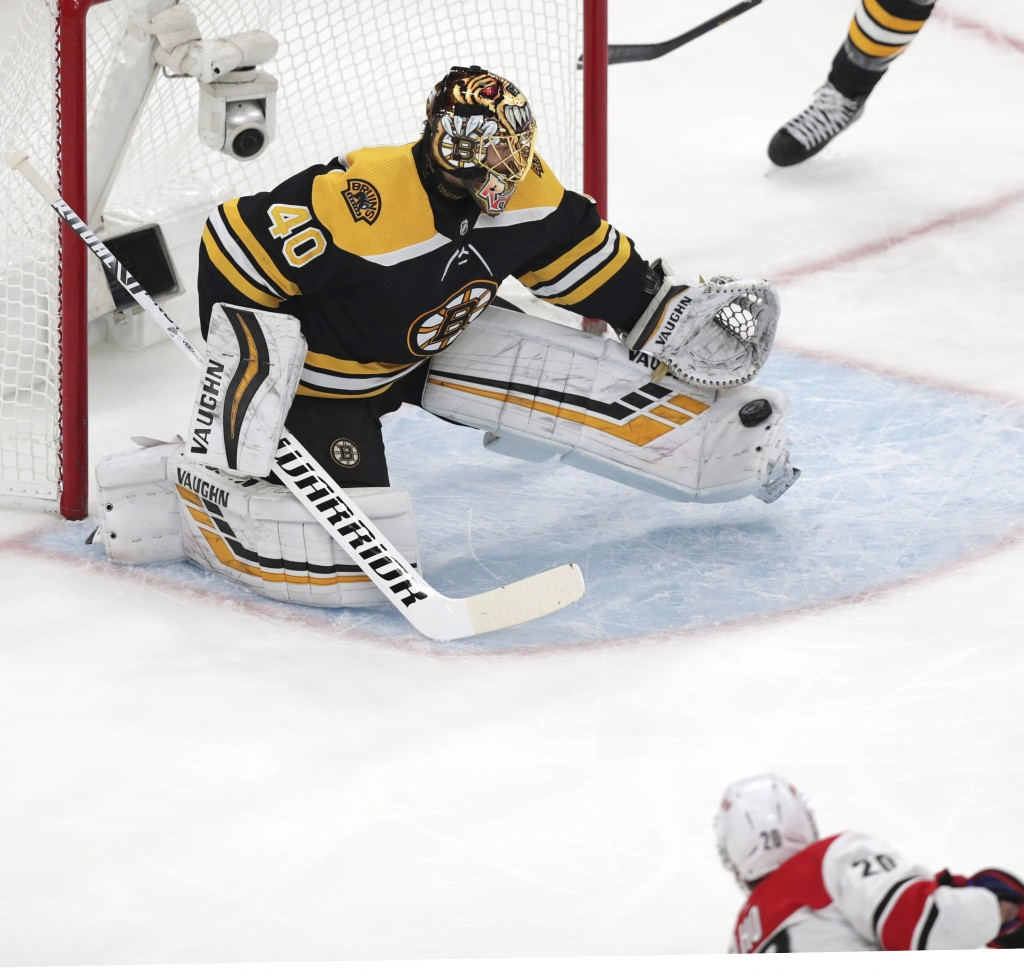 Boston Bruins goaltender Tuukka Rask (40), of Finland, makes a toe save on a shot by Carolina Hurricanes' Sebastian Aho (20), of Finland, during the f