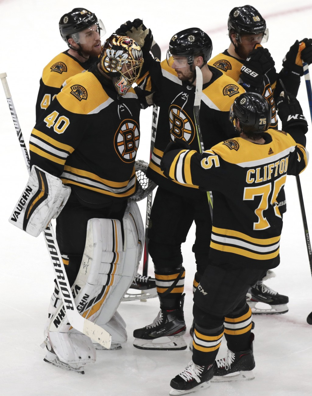 Boston Bruins goaltender Tuukka Rask (40), of Finland, is congratulated after the team's 5-2 win over the Carolina Hurricanes in Game 1 of the NHL hoc