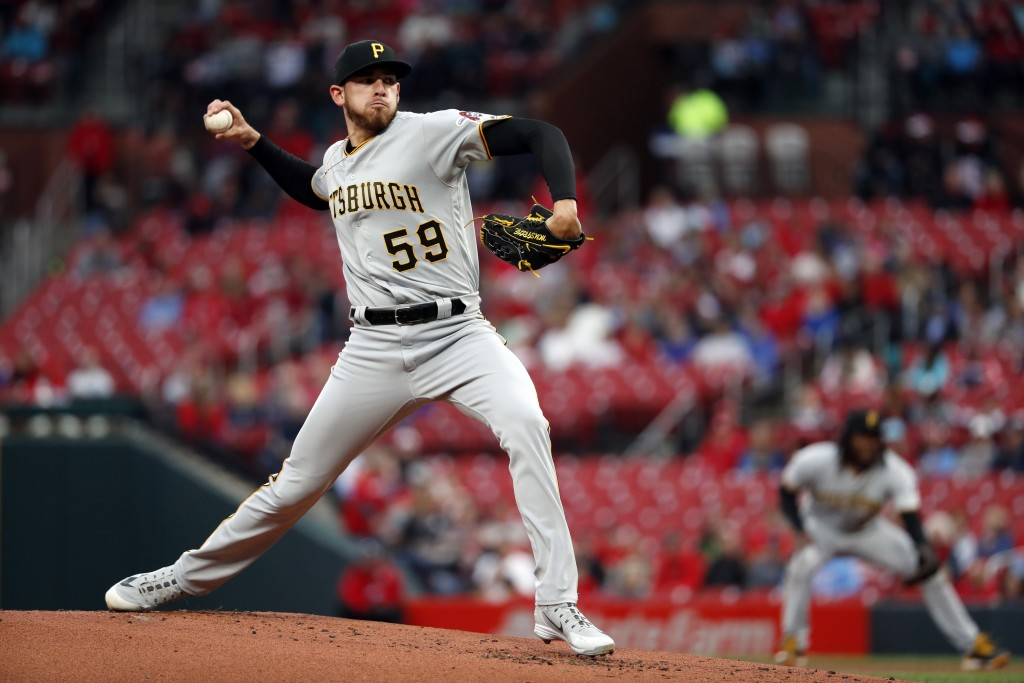 Pittsburgh Pirates starting pitcher Joe Musgrove throws during the first inning of the team's baseball game against the St. Louis Cardinals on Thursda