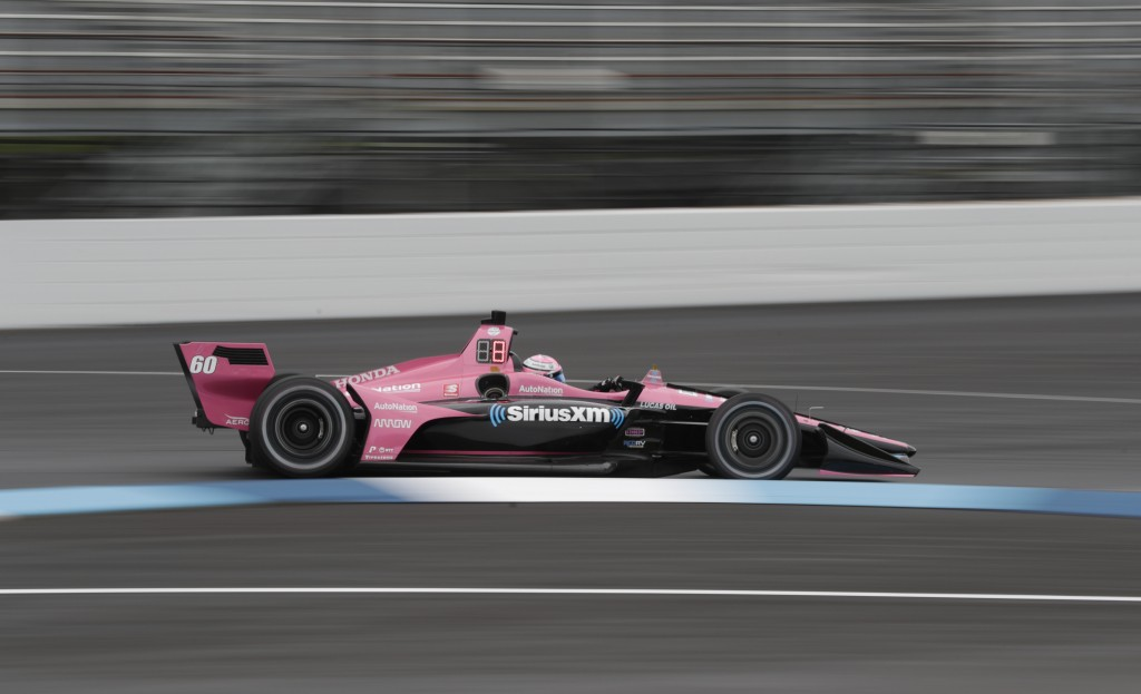 Jack Harvey, of England, drives through a turn during practice for the Indy GP IndyCar auto race at Indianapolis Motor Speedway, Friday, May 10, 2019