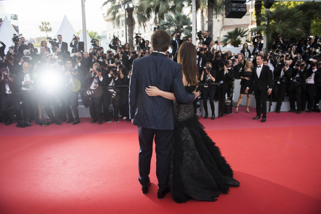 FILE - This May 8, 2018 file photo shows actors Penelope Cruz, right, and Javier Bardem posing for photographers at the opening ceremony of the 71st i