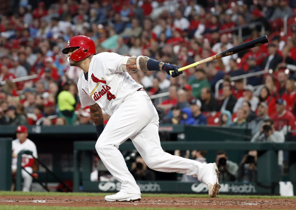 St. Louis Cardinals' Yadier Molina watches his RBI double during the second inning of the team's baseball game against the Pittsburgh Pirates on Thurs...