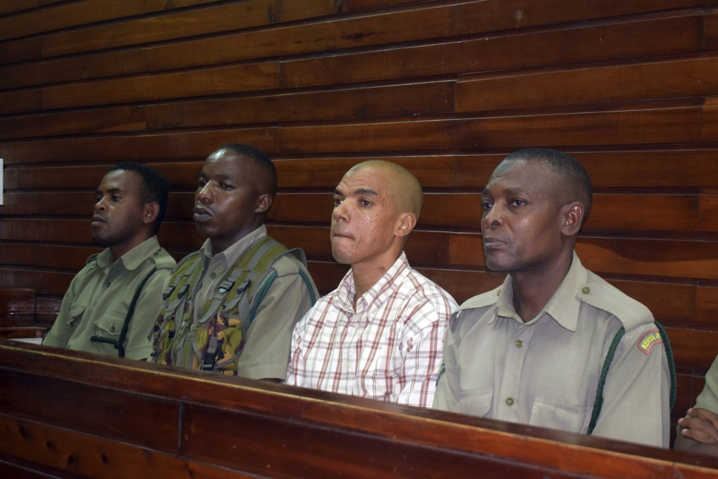 Guarded by heavy security, British suspect Jermaine Grant, second right, sits in a Mombasa court awaiting sentencing, in Mombasa, Kenya, Thursday, May...