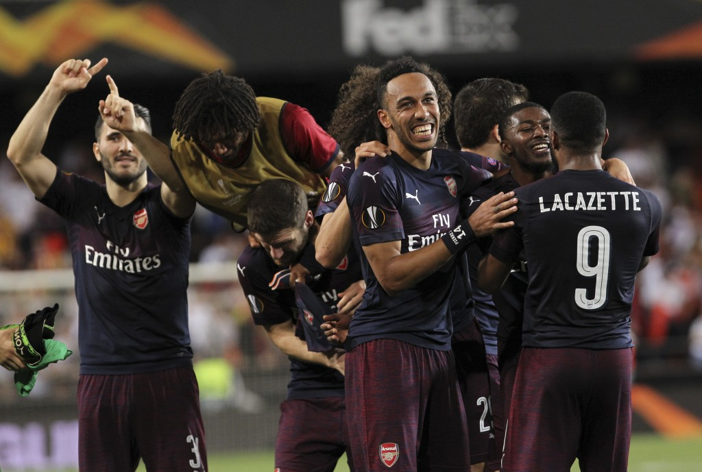 Arsenal players celebrate at the end of the Europa League semifinal soccer match, second leg, between Valencia and Arsenal at the Camp de Mestalla sta
