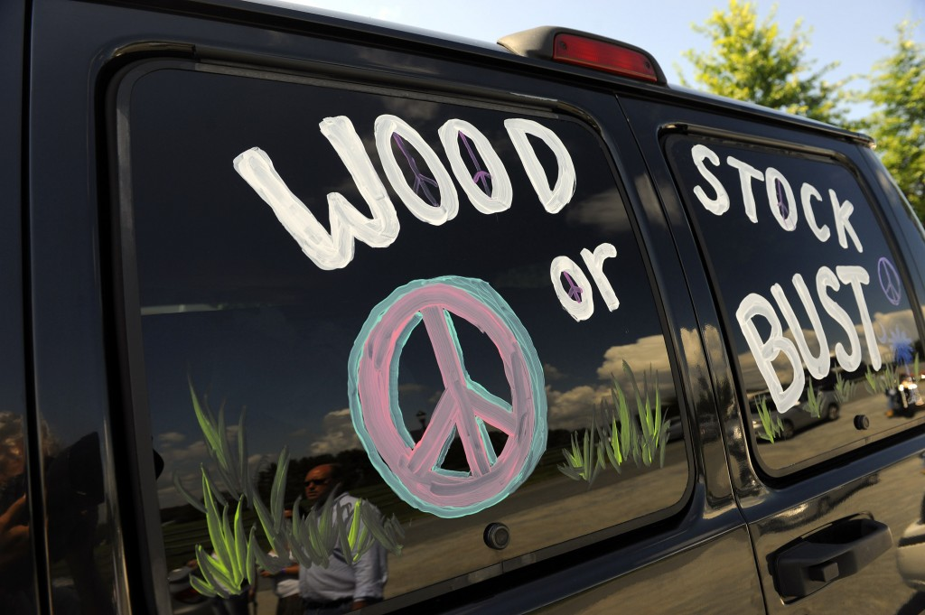 "FILE - This Aug. 14, 2009 file photo shows a van decorated with ""Woodstock or Bust"" at the original Woodstock Festival site in Bethel, N.Y. The Woodst"