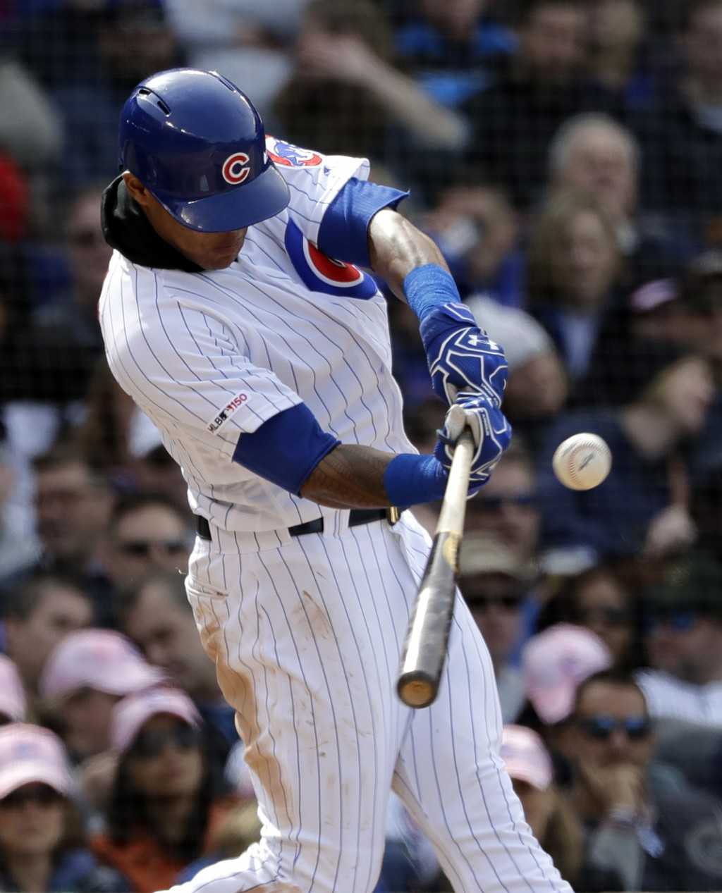 Chicago Cubs' Addison Russell hits a double during the seventh inning of a baseball game against the Milwaukee Brewers, Friday, May 10, 2019, in Chica...
