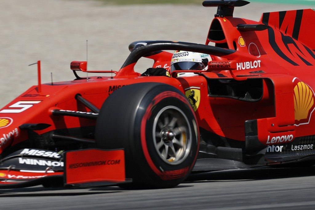 Ferrari driver Sebastian Vettel of Germany steers his car during a qualifying session at the Barcelona Catalunya racetrack in Montmelo, just outside B