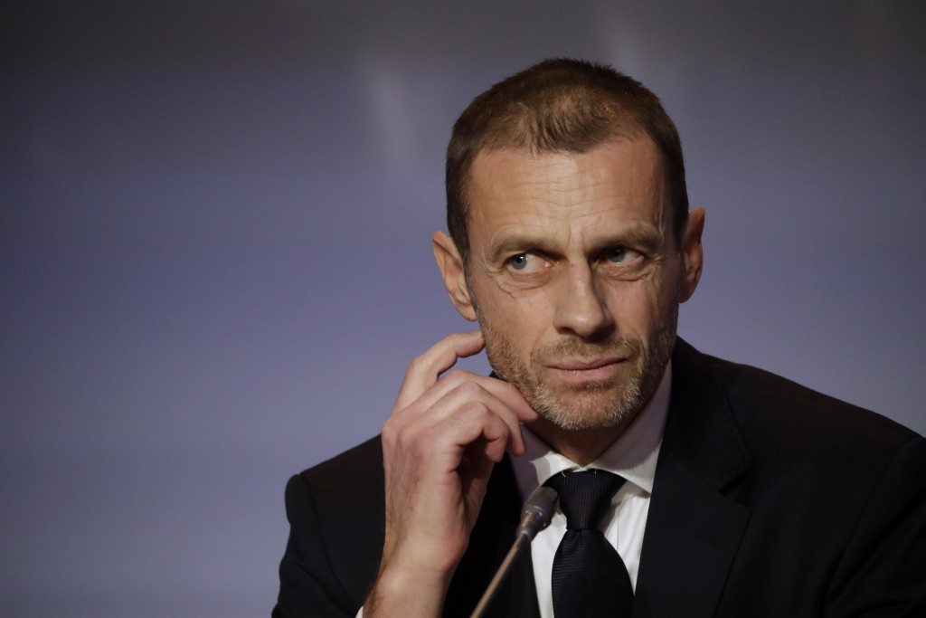 FILE - In this Thursday, Feb. 7, 2019 file photo, UEFA President Aleksander Ceferin listens to reporter's questions during a press conference at the e