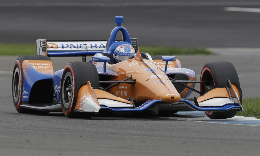 Scott Dixon, of New Zealand, steers his car during qualifications for the Indy GP IndyCar auto race at Indianapolis Motor Speedway, Friday, May 10, 20...