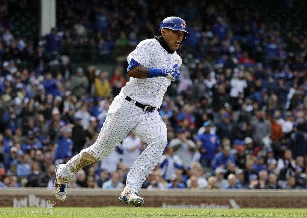 Chicago Cubs' Addison Russell runs after hitting a double during the seventh inning of a baseball game against the Milwaukee Brewers, Friday, May 10, ...