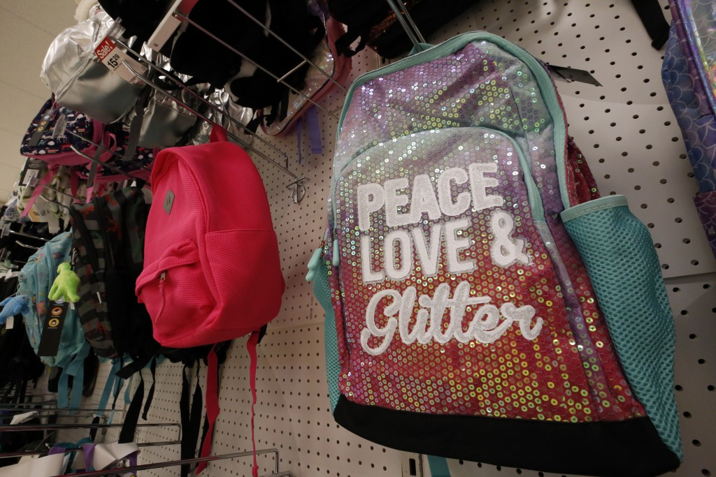 FILE - This July 18, 2018, file photo, shows a display of back to school backpacks in Pittsburgh. The latest round of China tariff hikes, which went i