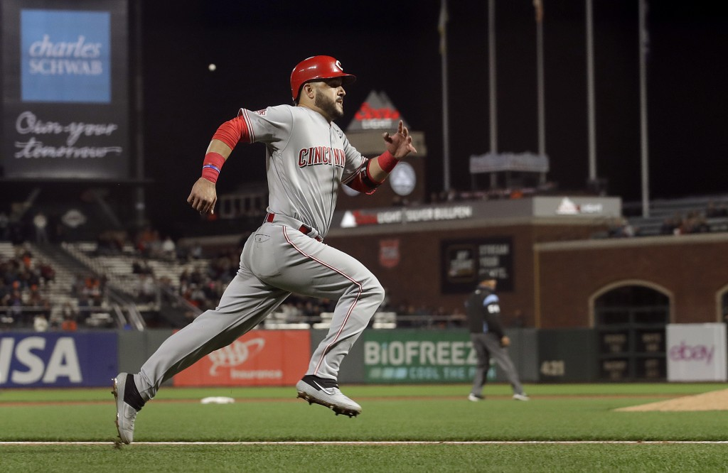 Cincinnati Reds' Eugenio Suarez runs home to score against the San Francisco Giants during the ninth inning of a baseball game in San Francisco, Frida