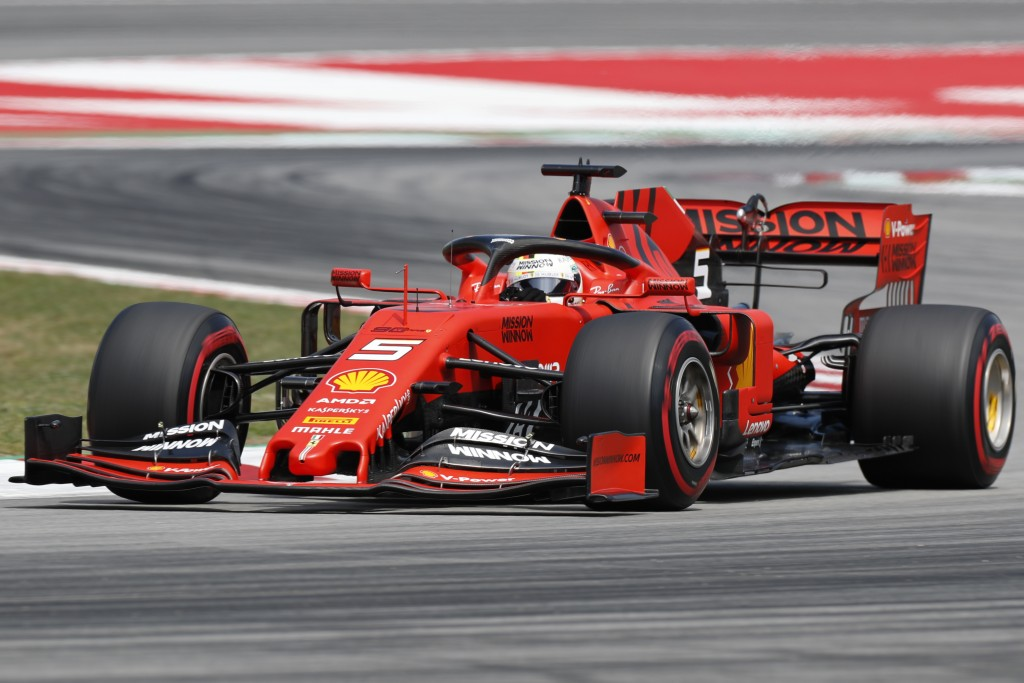Ferrari driver Sebastian Vettel of Germany steers his car out of a curve during a qualifying session at the Barcelona Catalunya racetrack in Montmelo,...
