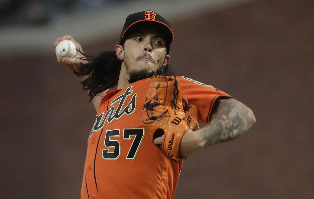 San Francisco Giants pitcher Dereck Rodriguez (57) throws against the Cincinnati Reds during the third inning of a baseball game in San Francisco, Fri