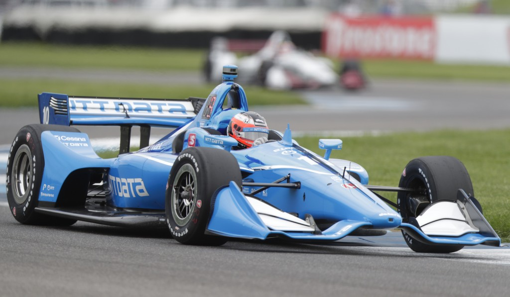 Felix Rosenqvist, of Sweden, drives through a turn during practice for the Indy GP IndyCar auto race at Indianapolis Motor Speedway, Friday, May 10, 2