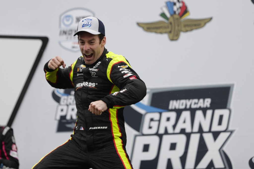 Simon Pagenaud, of France, celebrates after winning the Indy GP IndyCar auto race at Indianapolis Motor Speedway, Saturday, May 11, 2019, in Indianapo...