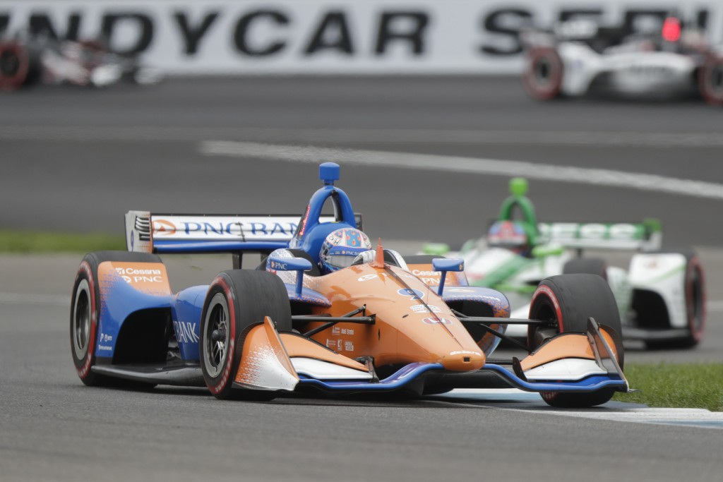 Scott Dixon, of New Zealand, drives through a turn during the Indy GP IndyCar auto race at Indianapolis Motor Speedway, Saturday, May 11, 2019 in Indi