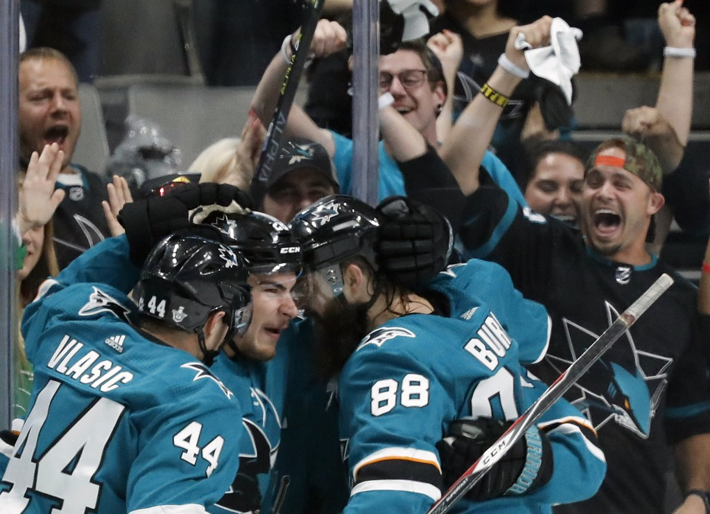 San Jose Sharks' Marc-Edouard Vlasic (44), Timo Meier (28) and Brent Burns (88) celebrate a goal by Meier against the St. Louis Blues in the second pe...