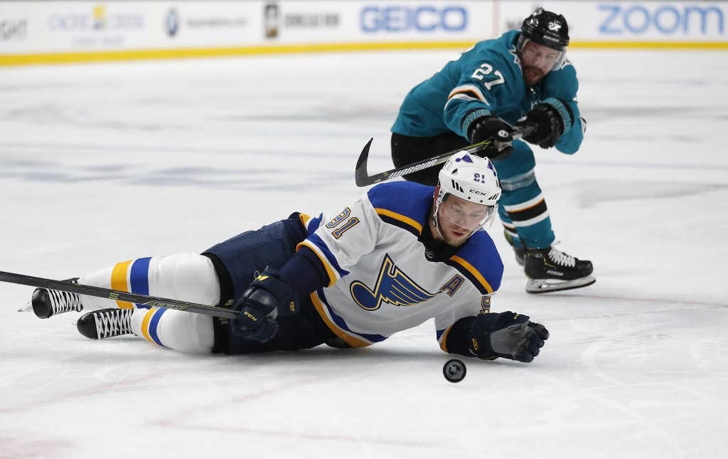 St. Louis Blues' Vladimir Tarasenko (91) battles for the puck against San Jose Sharks' Joonas Donskoi (27) in the second period in Game 1 of the NHL h