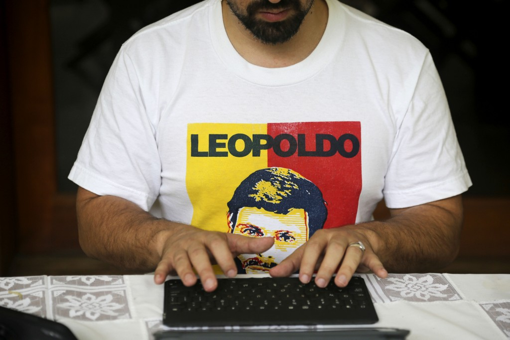 In this Saturday, May 11, 2019 photo, wearing a T-shirt featuring Leopoldo Lopez, Venezuelan opposition leader Freddy Guevara, exiled at the Chilean a...