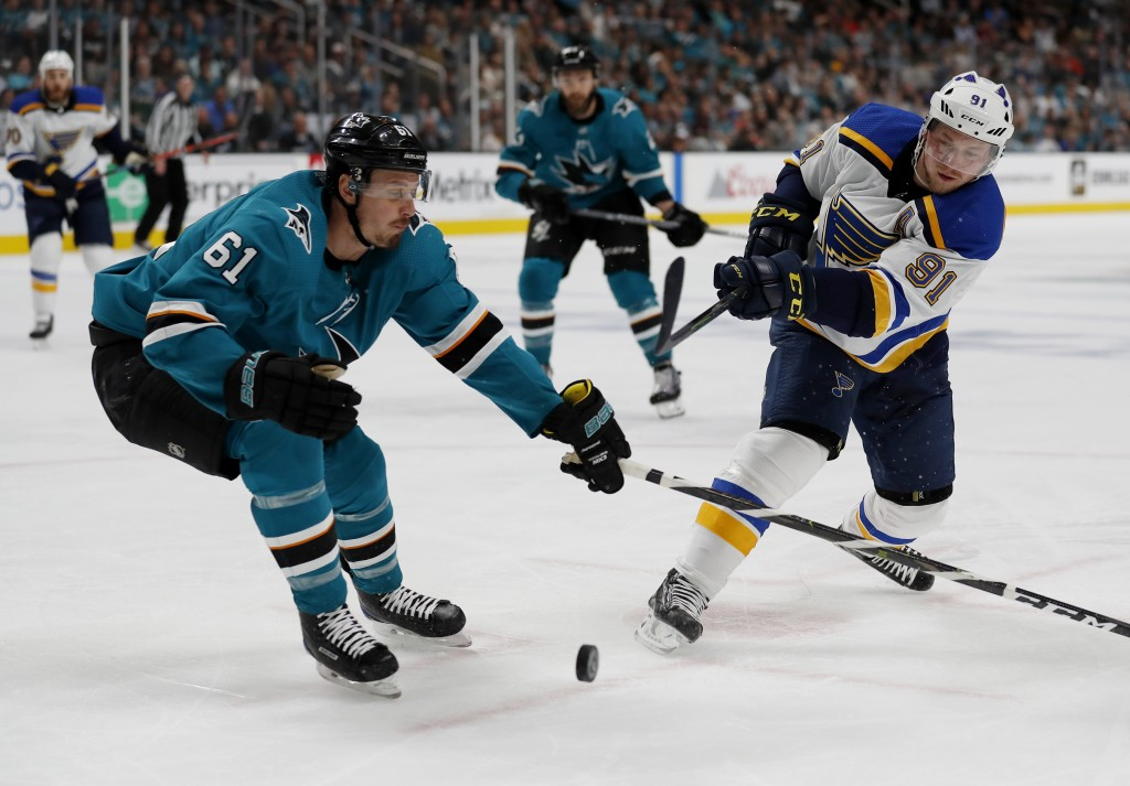 San Jose Sharks' Justin Braun (61) battles for the puck against St. Louis Blues' Vladimir Tarasenko (91) in the second period in Game 1 of the NHL hoc...