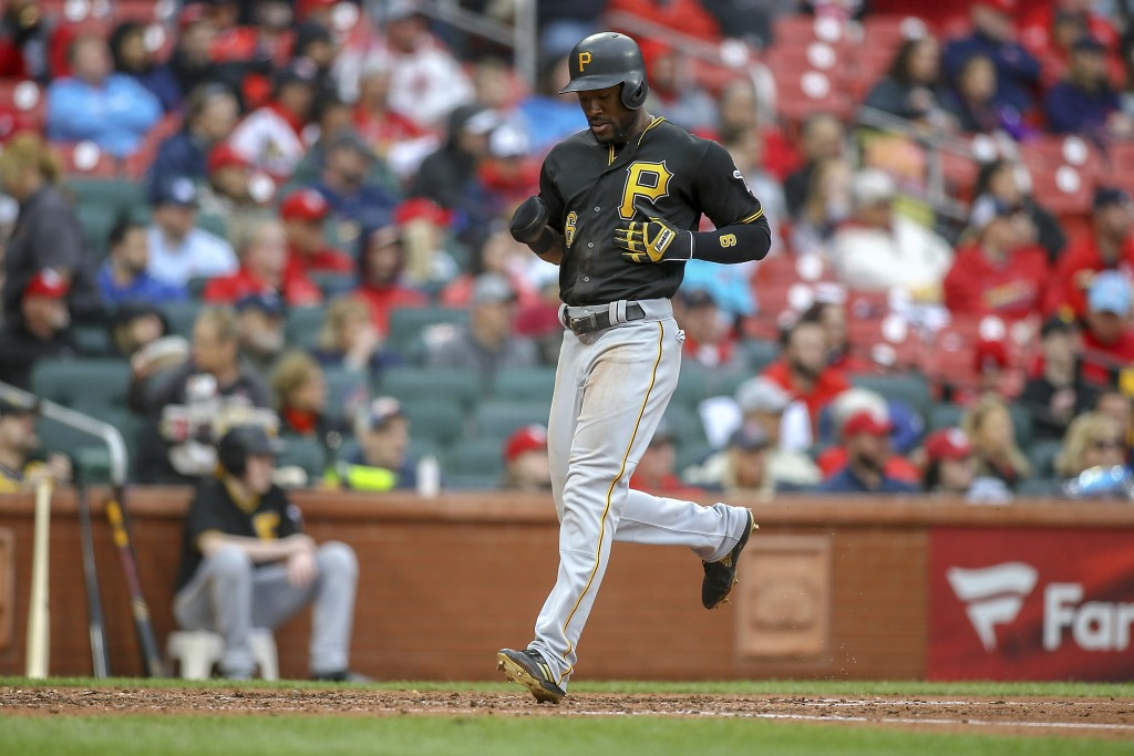 Pittsburgh Pirates' Starling Marte scores a run during the fourth inning of a baseball game against the St. Louis Cardinals, Saturday, May 11, 2019, i...