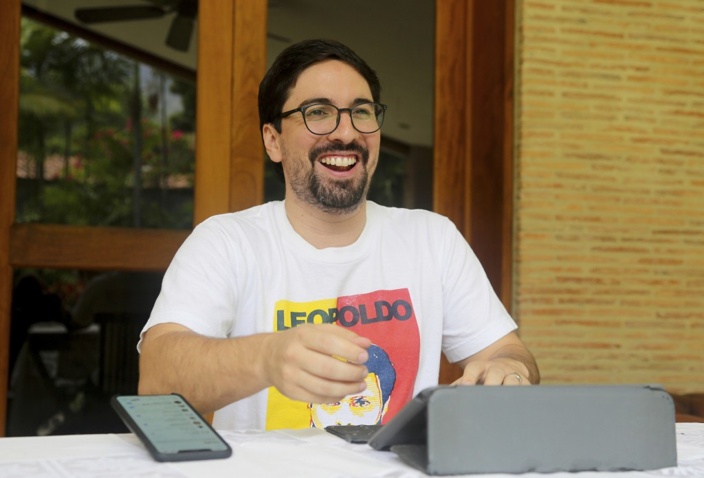 In this Saturday, May 11, 2019 photo, Venezuelan opposition leader Freddy Guevara, exiled at the Chilean ambassador's residence, smiles during an inte...