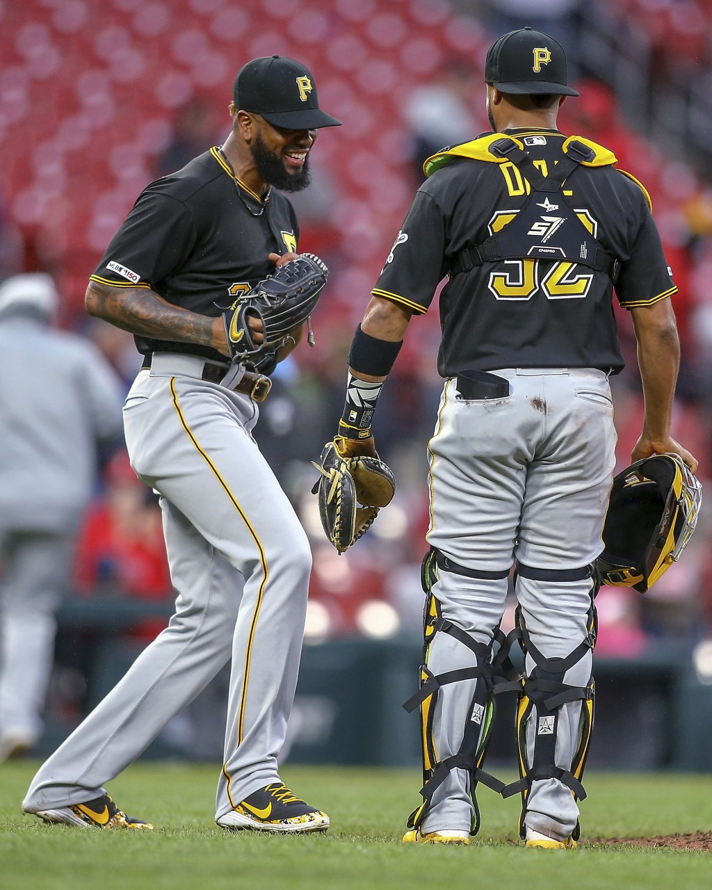 Pittsburgh Pirates relief pitcher Felipe Vazquez, left, celebrates with catcher Elias Diaz (32) after the final out of the team's baseball game agains...