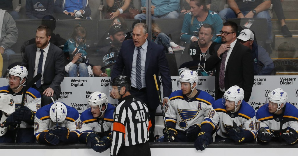 St. Louis Blues' head coach Craig Berube, center, reacts on the bench in the third period in Game 1 of the NHL hockey Stanley Cup Western Conference f