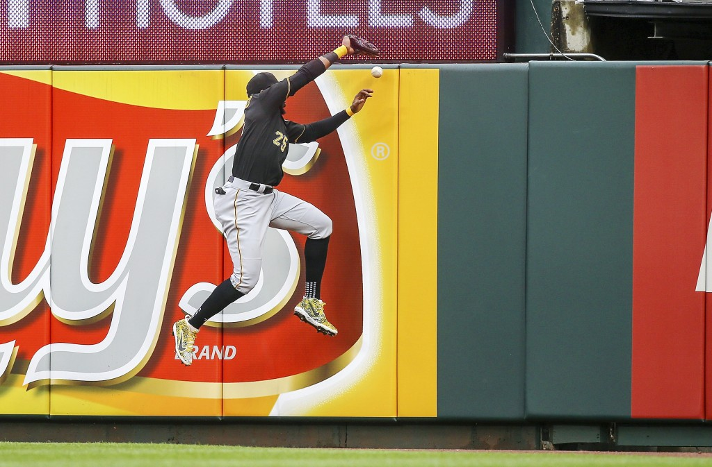 Pittsburgh Pirates right fielder Gregory Polanco (25) is unable to make a catch on a ball hit by St. Louis Cardinals' Paul DeJong for an RBI double du...