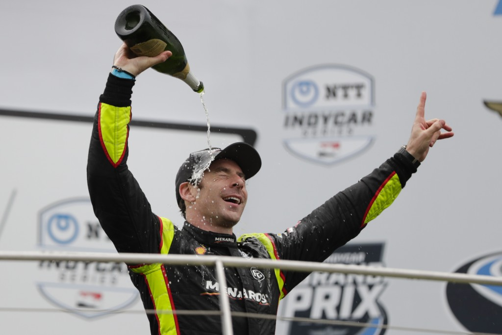 Simon Pagenaud, of France, celebrates after winning the Indy GP IndyCar auto race at Indianapolis Motor Speedway, Saturday, May 11, 2019, in Indianapo
