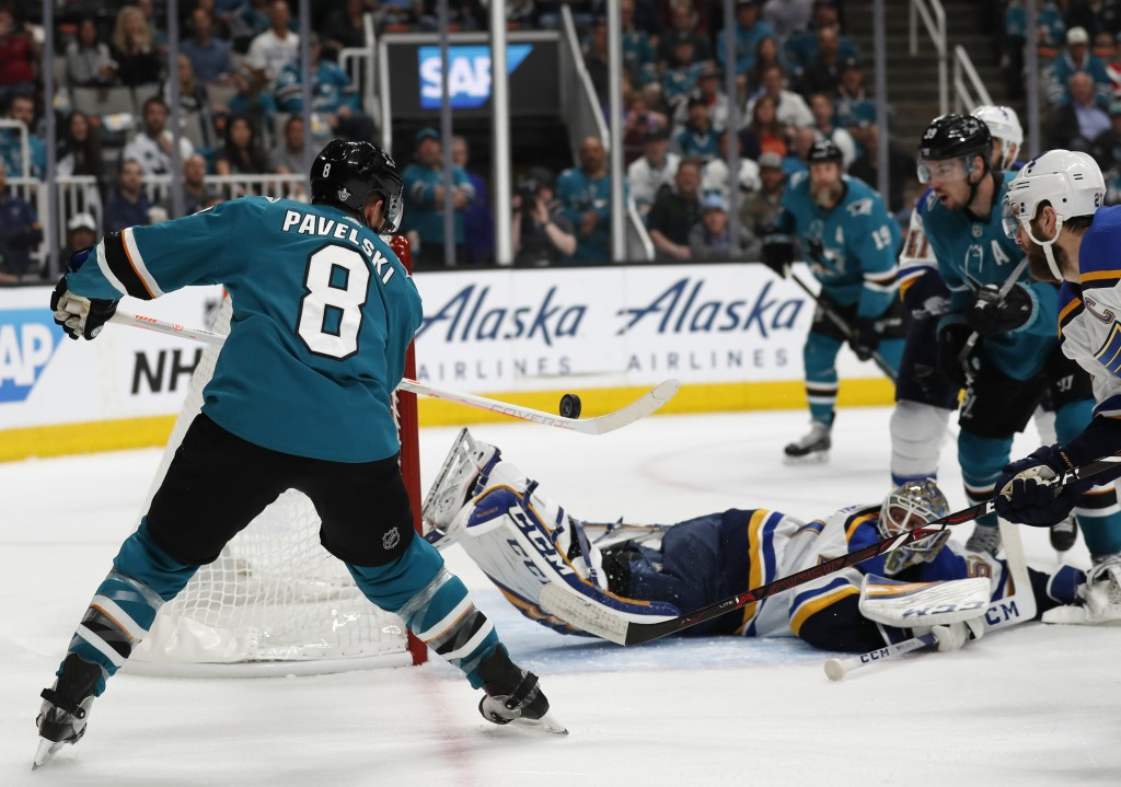 San Jose Sharks' Joe Pavelski (8) scores a goal against St. Louis Blues goaltender Jordan Binnington (50) in the first period in Game 1 of the NHL hoc
