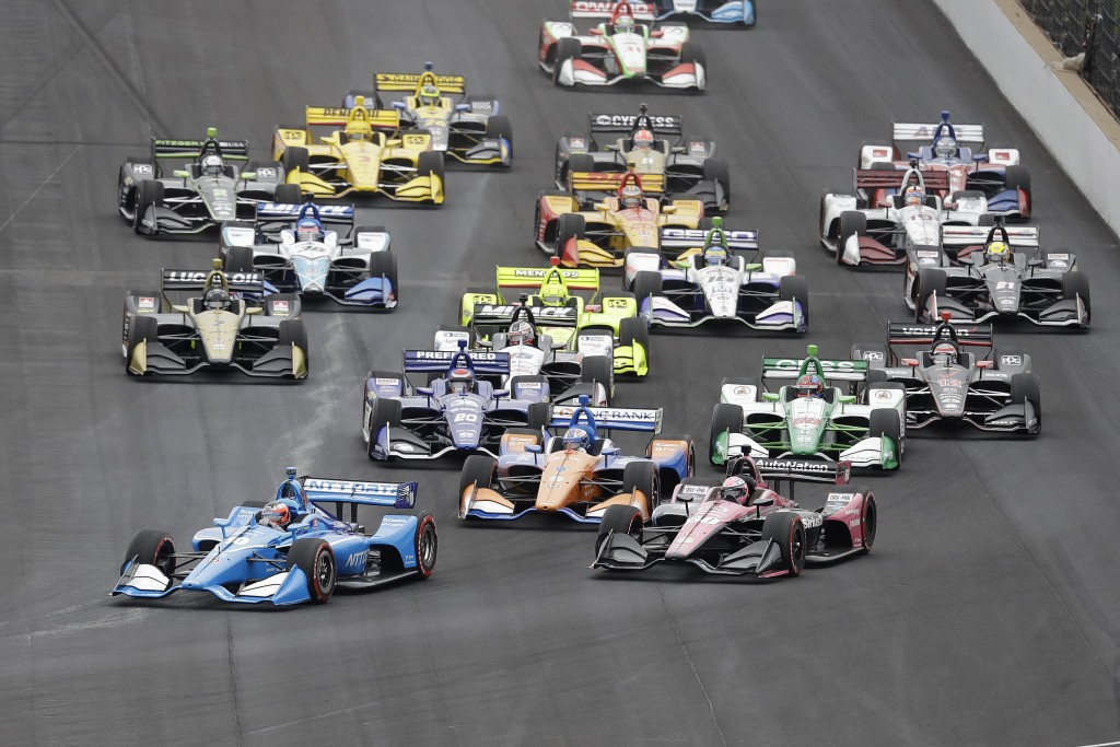 Felix Rosenqvist, of Sweden, leads the field into turn one at the start of the Indy GP IndyCar auto race at Indianapolis Motor Speedway, Saturday, May
