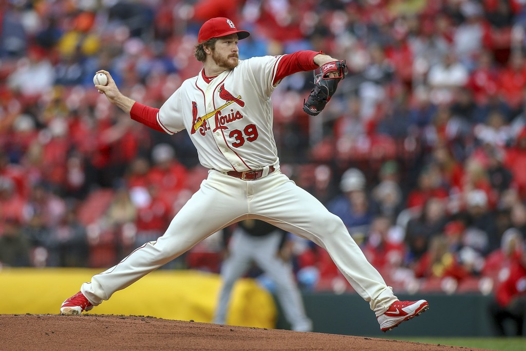 St. Louis Cardinals starting pitcher Miles Mikolas throws during the first inning of a baseball game against the Pittsburgh Pirates, Saturday, May 11,...
