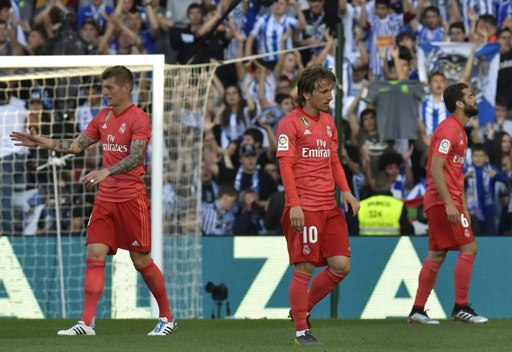 Real Madrid's Toni Kroos, left, Real Madrid's Luka Modric, centre, and Real Madrid's Nacho Fernandez walk on the pitch in dejection at the end of the ...