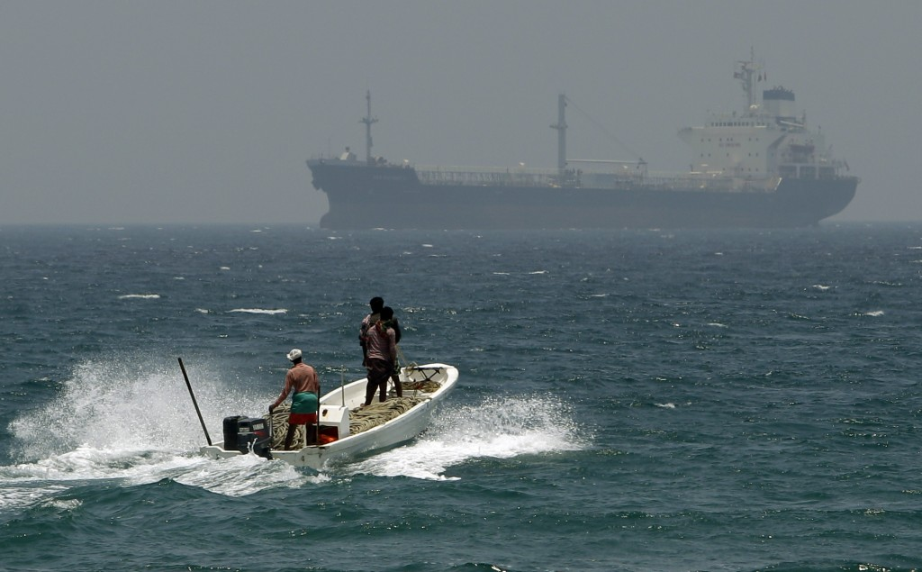 FILE - In this May 30, 2012, file photo, fishermen cross the sea waters off Fujairah, United Arab Emirates, near the Strait of Hormuz. The United Arab...